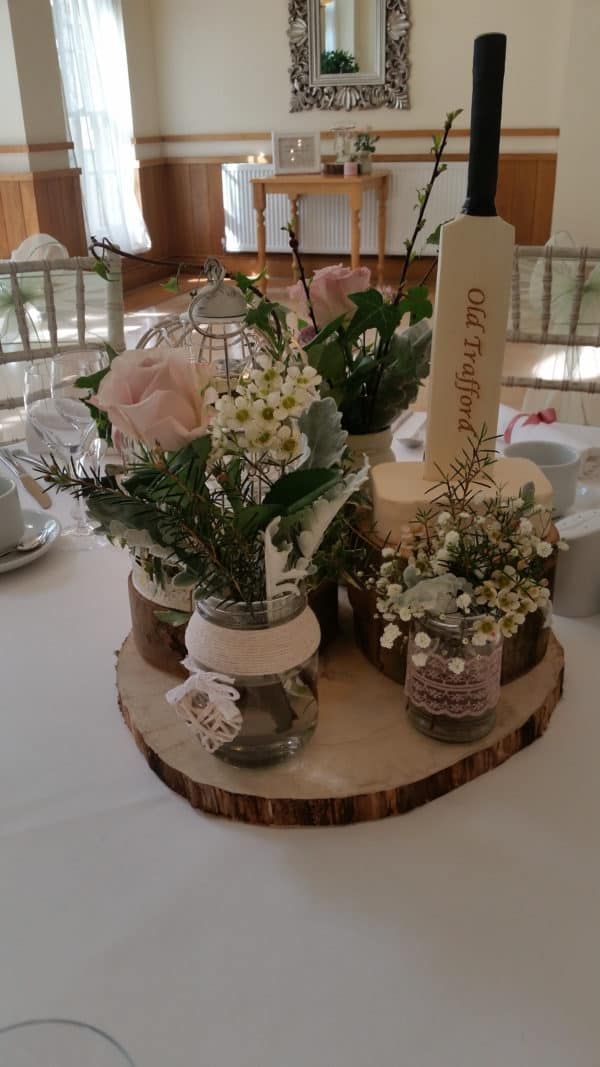 Jars and bottles with flowers and wood plates 1
