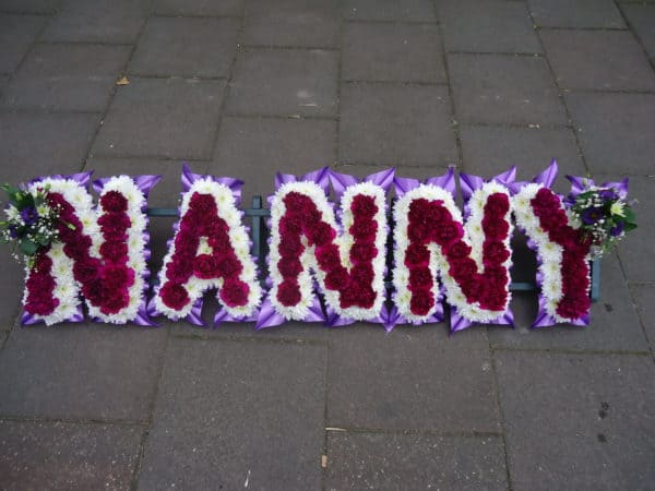 Nanny Frame with Purple Carnations 1